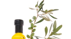 Raw olives with oil on white Stock Footage