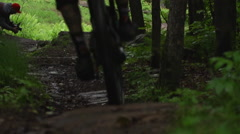 Extreme Sport Mountain Biking - Riding off a jump - stock footage