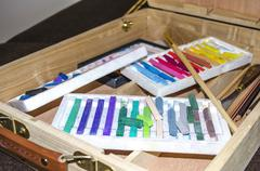 Soft pastels in wooden case Stock Photos