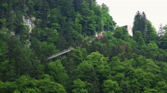 4k Salzwelten cable car in Hallstatt alps mountain forest Stock Footage