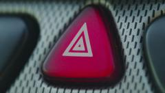 Close up of blinking hazard light on the dashboard of a car Stock Footage