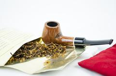 Tobacco pipe with tobacco leaves and pouch Stock Photos