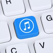 Computer concept listening music download streaming and buying on internet Stock Photos