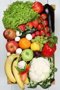 Fruits and vegetables like oranges, apple in wooden box groceries Stock Photos