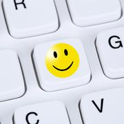 Computer concept happy smiley symbol assessment feedback Stock Photos