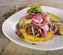 Arepas, Fried Cornmeal Patties,with Ground Beef,Avocado,Red Onions and Jalapeno Stock Photos