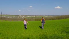 Children run across the meadow and rejoice Stock Footage