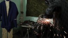 Angle Grinder clears the metal, the man in goggles and mask, Sparks in the Dark Stock Footage