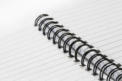 Close up of a spiral bound notebook with black spirals - stock photo