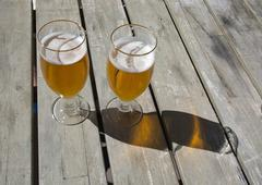 Two beers on rustic wooden table Stock Photos