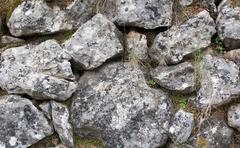 Old rocks in drystone wall Stock Photos