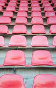 Red seats at soccer sports stadium Stock Photos