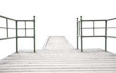 Wood pier with iron railing - stock photo