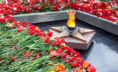 Eternal flame and flowers in memory of the Victory in the Great Patriotic War Stock Photos