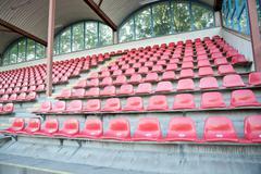 Red seats at soccer sports stadium Stock Photos