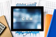 CRM or Customer relationship management word on tablet - stock photo