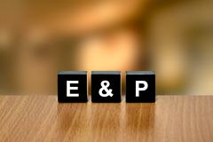 E&P or Exploration and Production on black block - stock photo