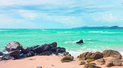 Small Waves Break over Boulders at a Tropical Beach Stock Footage