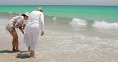 Grandmom  Mom and Little Girl Playing at the Beach Stock Footage