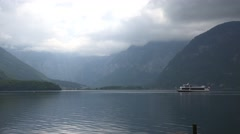 4k Ferry boat on Hallstatt mountain lake at a cloudy day Stock Footage