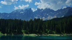 Mountain range. forest and lake in Italian Alps Stock Footage