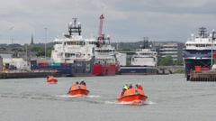 A Training exercise with small boats inside Aberdeen Harbour, Scotland Stock Footage