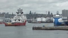 Large Oil support ship manoeuvring inside Aberdeen Harbour, Scotland Stock Footage