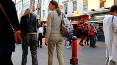 Hundreds of tourists and locals  at the streets of Chinatown in evening time Stock Footage