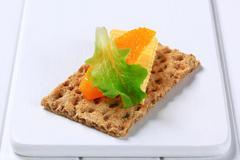 Whole grain crisp bread with butter Stock Photos