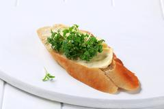 Bread with butter and cress - stock photo