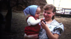 Stock Video Footage of (8mm Vintage) 1952 Iowa Mother Introducing Baby To Chicken Hatchling