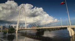 Dallas Skyline, Margaret Hunt Bridge, and flooded Trinity River Stock Footage