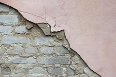 collapsing wall - stock photo