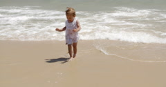 Cute little girl pointing out to sea Stock Footage