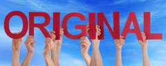 Hands Holding Red Straight Word Original Blue Sky - stock photo