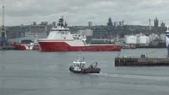 Small support vessel coming into Aberdeen Harbour, Scotland Stock Footage