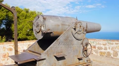 BARCELONA, SPAIN, old canon overlooking port from fortress Castell de Montjuic Stock Footage