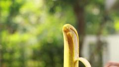 Peeling the banana, close up shot Stock Footage