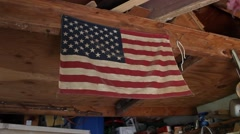 Small American Flag in Garage Shop Stock Footage