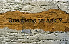 Questions to ask text on grunge background Stock Photos
