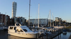 Stock Video Footage of yacht in the harbor Turning Torso Building Malmo Sweden1