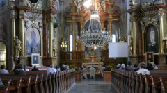 Stock Video Footage of Church service in the  Catholic church in Warsaw, Poland