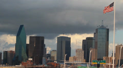 Dallas Skyline, highway, american flag and storm clouds Stock Footage