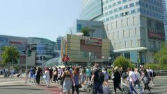 Busy pedestrian crossing in modern shopping center area. Warsaw downtown Stock Footage