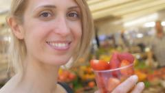 Beautiful woman eats fruits in a plastic glass: tourist woman in Rome Stock Footage