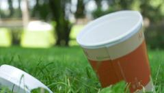 rude man throws down a plastic cup for  takeaway coffee - stock footage
