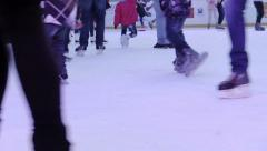 Legs of people over the ice making ice-skating Stock Footage