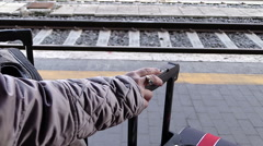 woman with luggage waiting the train: train station, passenger, journey - stock footage