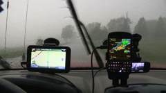 Stormchaser caught in severe rain and wind in tornado warned thunder storm Stock Footage