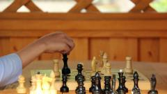game of chess with a child, ending the game mat, an explanation - stock footage
